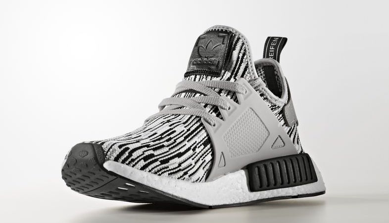 This adidas NMD XR1 comes constructed out of a Primeknit upper that  combines black and white while using a glitch print/pattern. Grey is then  placed on the ...